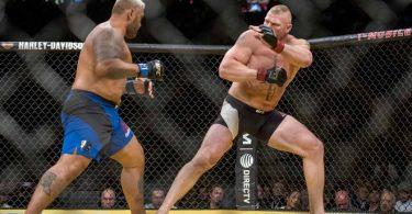 Jul 9, 2016; Las Vegas, NV, USA; Mark Hunt (blue gloves) fights Brock Lesnar (red gloves) during UFC 200 at T-Mobile Arena. Mandatory Credit: Joshua Dahl-USA TODAY Sports